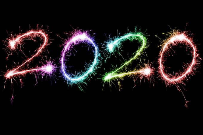 Colorful rainbow colored 2020 fireworks display with sparkling trails forming the date in a dark sky for a festive New Year celebration
